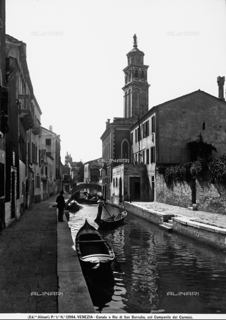 View of Rio di San Barnaba in Venice, with the bell tower of the church of the Carmini.