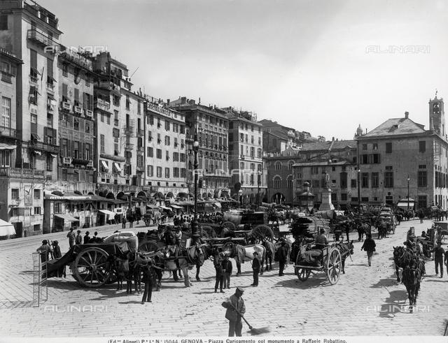 Busy view of piazza Caricamento in Genoa, in the background is the sailor Raffaele Rubattino sculpted by Augusto Rivolta.