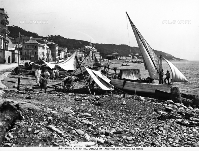 View of the marina of Cogoleto, on the Riviera of Genoa. Some children playing and some fishermen and boats are visible.