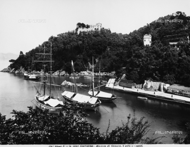 Boats anchored in the port of Portofino, located near Genoa. The castles can be seen on the hill