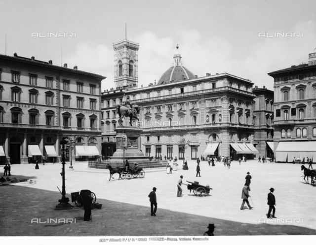 "View of Piazza della Repubblica, formerly Vittorio Emanuele II with monument of the same names (located since 1932 in the piazza opposite le Cascine), Florence. The coffee ""Pastry Luigi Gilli"" in the old location in Via degli Speziali"