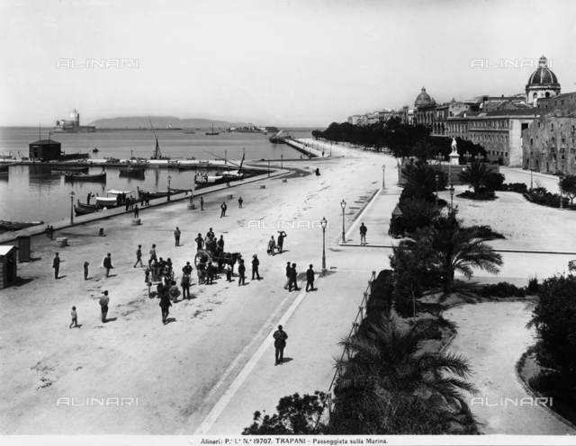 People strolling along the seafront of Trapani