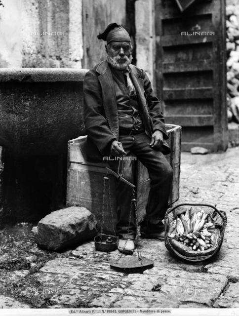 Fish vendor in traditional dress, in Girgenti