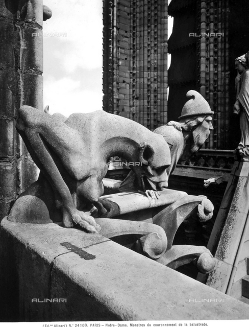 Figure of a demon and a bearded figure. Detail of the Cathedral of Notre-Dame, Paris.