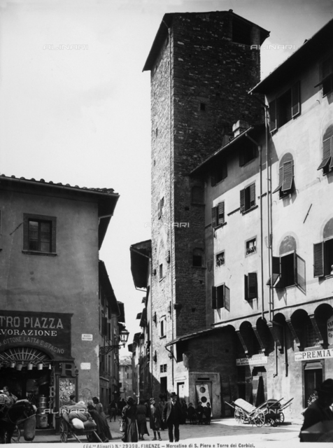 View with people of the Mercatino di San Piero. The Corbizi Tower is in the background