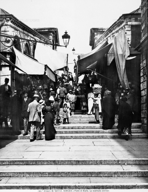 View of the Rialto Bridge with people, in Venice