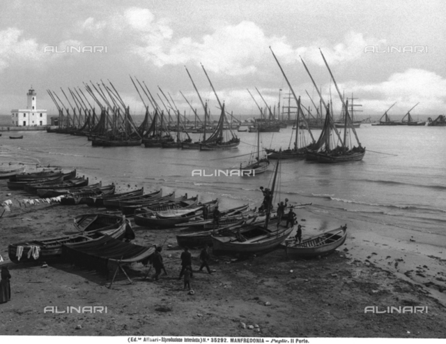 The port of Manfredonia dotted with boats lying at anchor