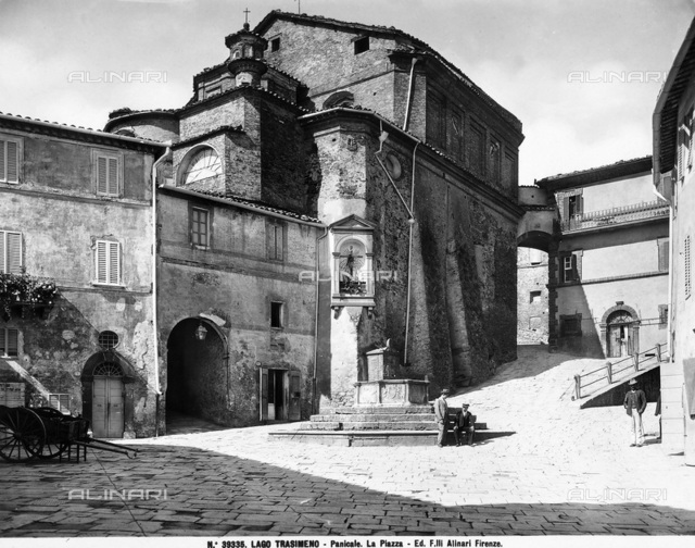 View of the piazza of the town Panicale, environs of Laek Trasimeno. In the center is a church with a tabernacle, under it is a well with steps.
