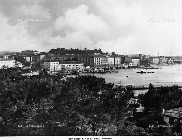 Panoramic view of the port of Pola, with moored boats, photographed during the period of Italy's reign in Istria