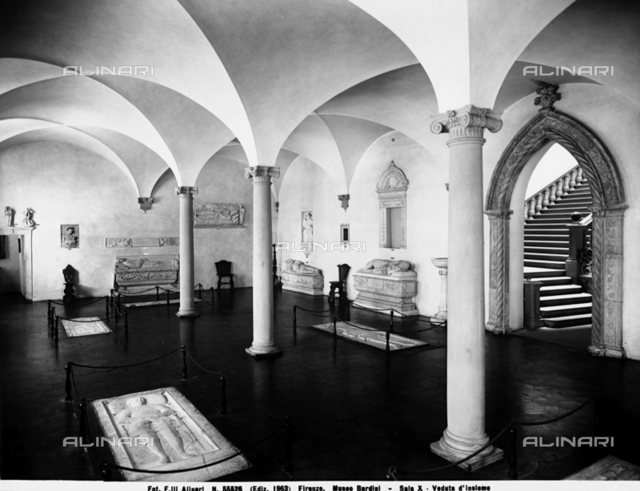 Partial view of Hall X of Bardini Museum, Florence. Tombstones and funeral monuments are visible.