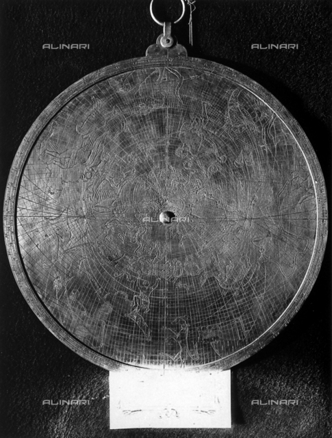 Universal Astrolabe from the sixteenth century preserved in the Astronomic Observatory of Rome. The picture shows the rear part of the object where there are representations of the constellations. The picture was taken during the Exhibition of Science History in 1929, in Florence.