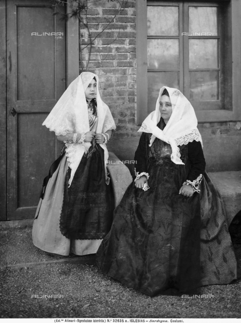 Two Sardinian women of Iglesias, Sardinia, in traditional dress