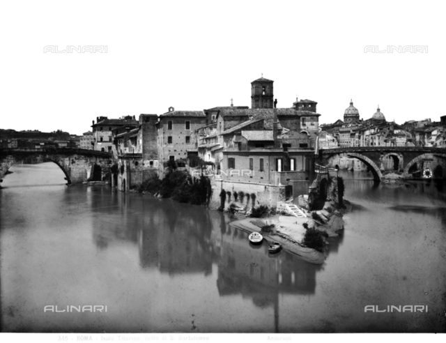 View of the Tiber and Tiber Island in Rome. To the right the Ponte Fabricio and on the left the Ponte Cestius
