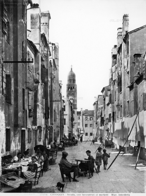 Street in Chioggia with women embroidering