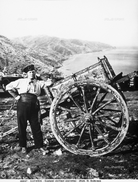 Man in costume next to a Sicilian cart