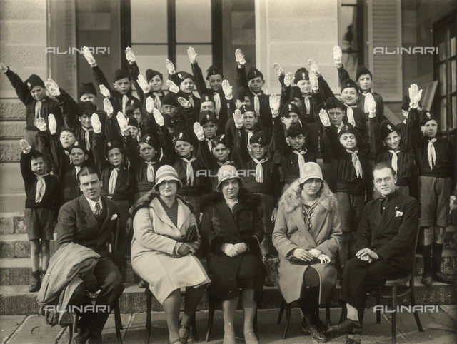 The Italian Fascist Youth Movement of the fourth grade, doing the Fascist salute