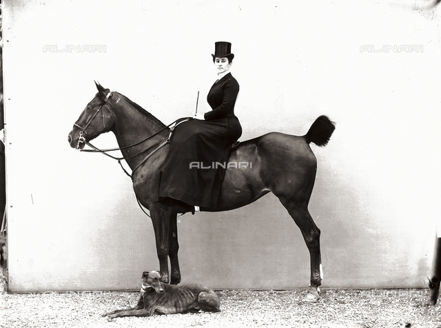 Portrait of a woman on a horse, with a greyhound sitting next to them
