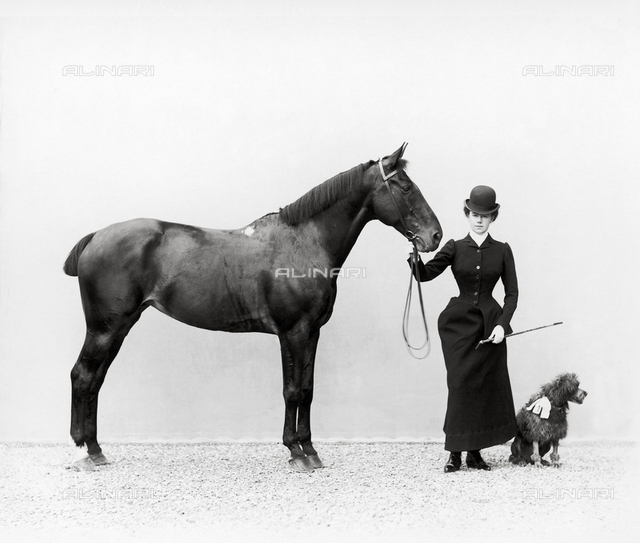 Portrait of Miss Walsh with a horse and a miniature poodle at Villa di Montefonte, in the Poggio Imperiale area of Florence