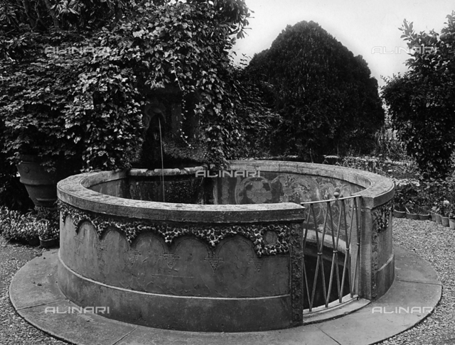 Fountain enclosed by a balustrade and gate in the garden of Villa Boklin, Fiesole