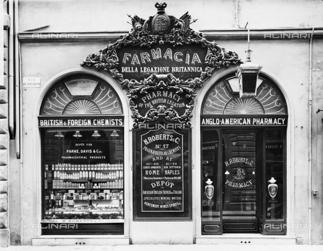 View of the windows of the English Pharmacy on Via Tornabuoni, Florence.