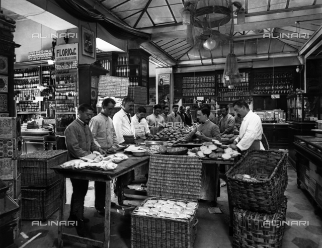 Workers for school meals for the town of Florence: the preparation of sandwiches in a grocery store