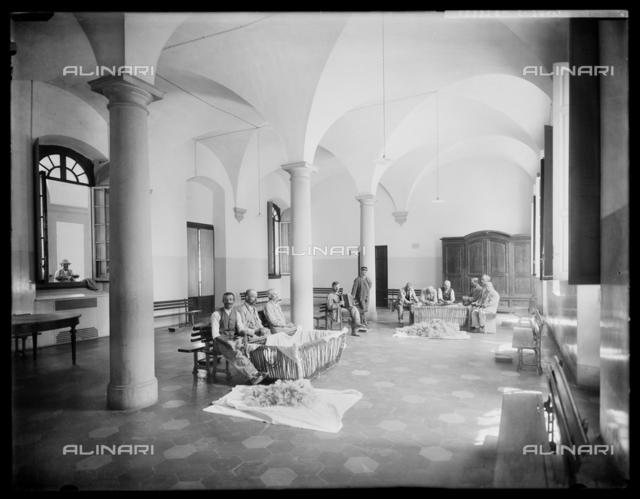 Florence. Hospital of San Salvi. Patients carding wool