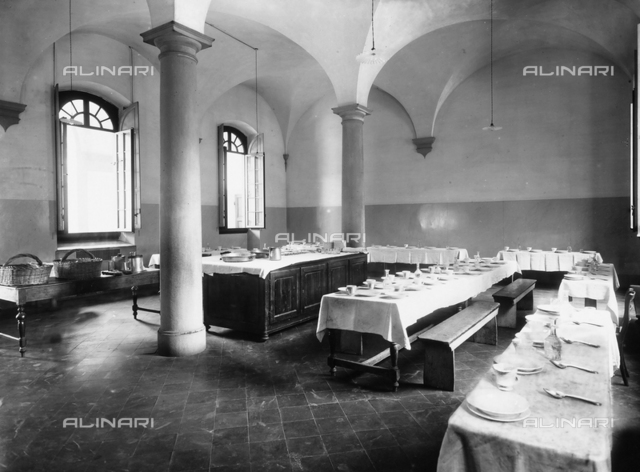 Refectory with set tables in the hospital of S. Salvi, Florence.