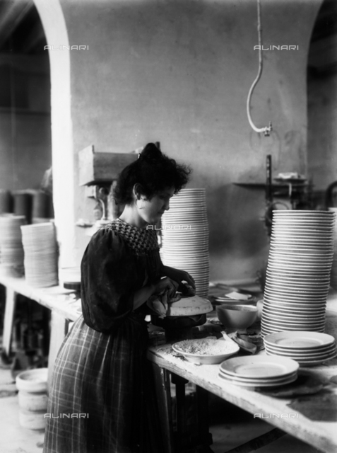 A worker of the ceramic products in the Ginori Factory, in Doccia near Florence