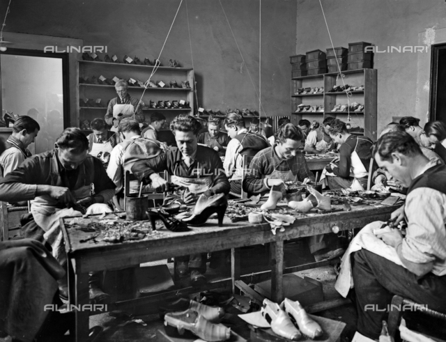 Craftsmen at work in the studio of footwear designer and manufacturer Ferragamo in Palazzo Feroni, Florence.
