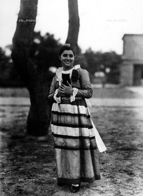 Villa Rosa Maltoni Mussolini: portrait of an adolescent holding a small cat, wearing a traditional Italian costume