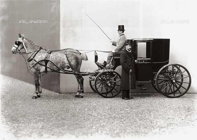 Conte della Gherardesca photographed while standing next to his carriage driven by a coachman