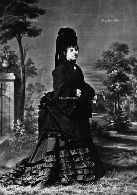 Portrait of lady in elegant dark dress