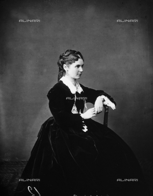Portrait of young woman, sitting, in nineteenth century costume