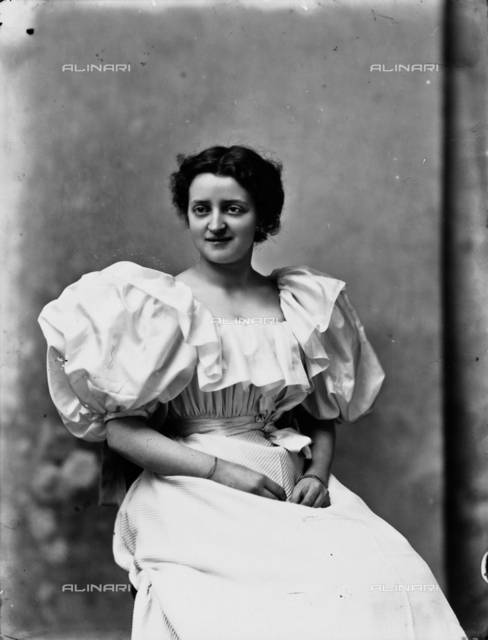 Portrait of woman in white dress