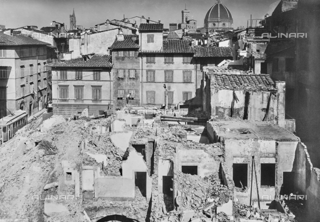 Demolition work during the renovation of the Santa Croce neighborhood in Florence. The dome of the Cathedral is visible in the background