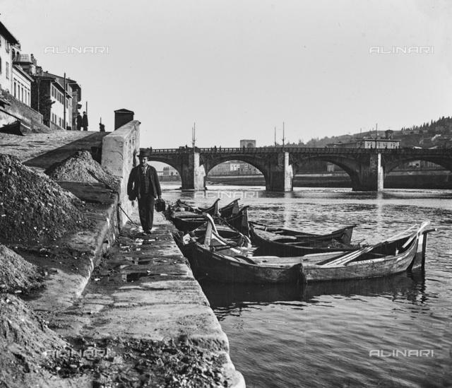 Boats near Ponte alle Grazie (already Rubaconte Bridge) in Florence