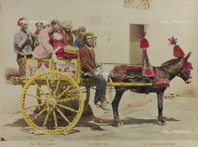 A group of people on a Sicilian cart drawn by a donkey, in Palermo