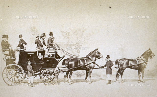 English stagecoach with passengers, drawn by four horses. A coachman is sitting on the box