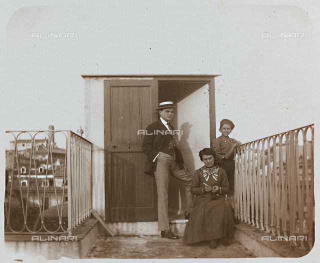 Portrait of a man, a woman and a child posing on a terrace