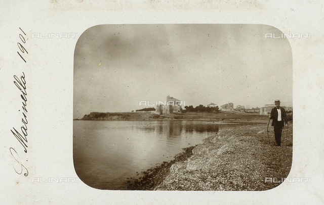 Beach of Santa Marinella (Rome) with vision in the distance of the medieval castle of Santa Severa