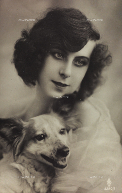 Portrait of a young woman with a dog, postcard