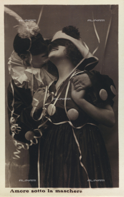 """""""Love under the mask"""", A young couple masked kissing under the streamers, postcard"""