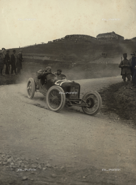 Car race at the Mugello circuit: a race car that goes fast on the track and some of those attending