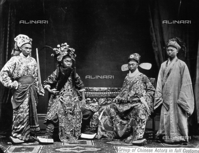 Full-length portrait of a group of Chinese actors wearing costumes of the traditional Chinese theater