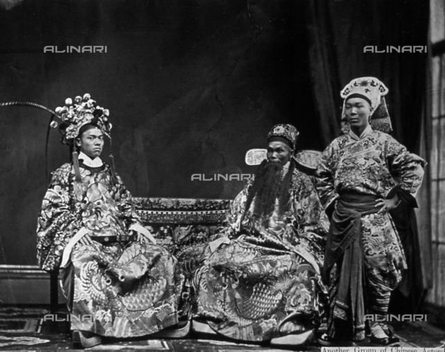 Full-length portrait of three Chinese actors in sumptuous traditional theatre costumes