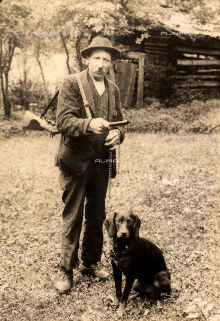 Portrait of a hunter with his dog.