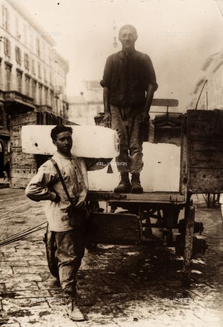 Full-figure portrait of two ice vendors.