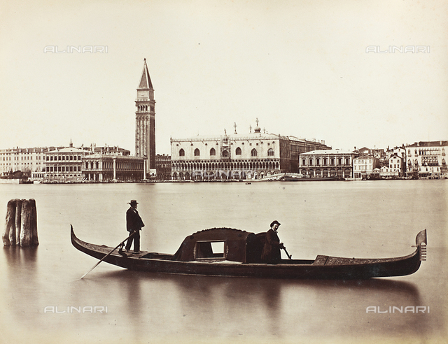 Gondoliers in the Venetian lagoon with the Bank of the Schiavoni in the background