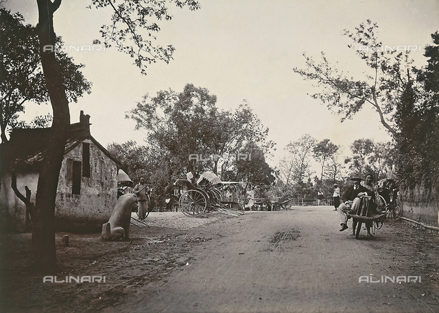 European tourist in a rickshaw, on a country road