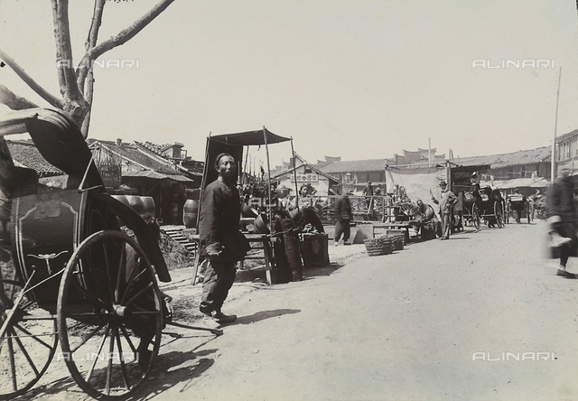 Workers and vendors on a street of a Japanese town